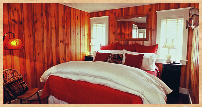 Luxurious bed inside Heart's Desire Cottage at Nick's Cove