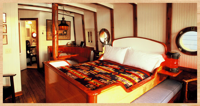 The bed inside the Nicolina waterfront cottage at Nick's Cove on Tomalas Bay just north of San Francisco