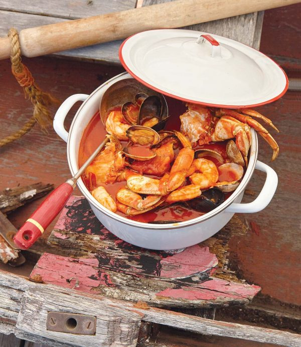 a pot of shrimp in a red sauce